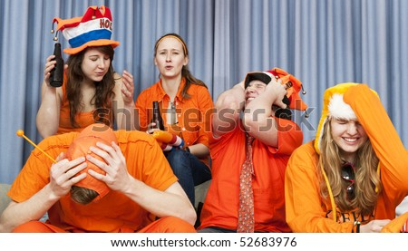 The expression of fans seeing their national team loose an important match - stock photo