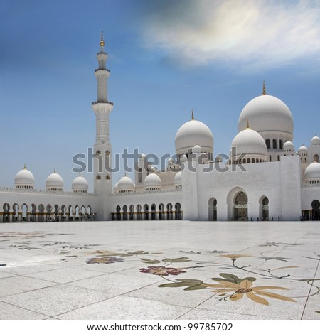 The exterior and front view of world famous landmark Sultan Sheikh Zayed Mosque in Abu Dhabi, UAE. Considered as 8th largest mosque in the world. - stock photo