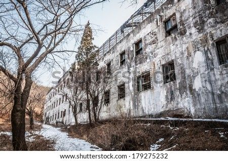The exterior of Gonjiam Psychiatric Hospital in South Korea. The building was abandoned nearly twenty years ago, but never demolished. - stock photo