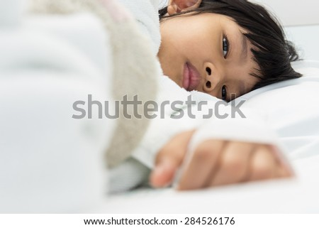 The eyes of a girl lying on a hospital bed,dept of field - stock photo