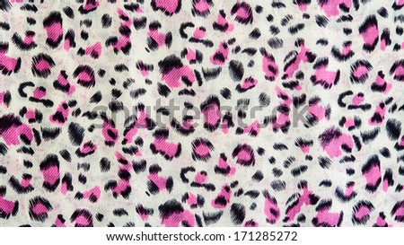 The fabric of motifs leopard on background - stock photo
