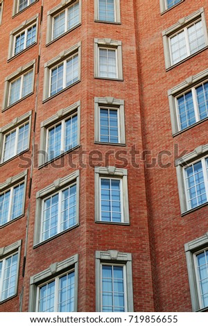 The Facade Of A Modern Multi Storey Brick Apartment Building