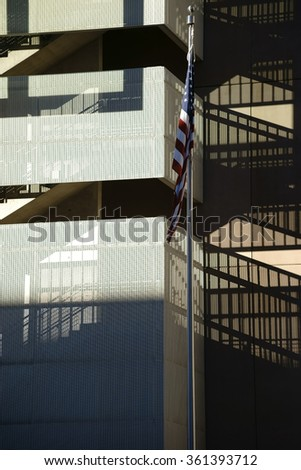 The facade of a modern residential building with a staircase, which casts a shadow / Stairway casts shadows - stock photo