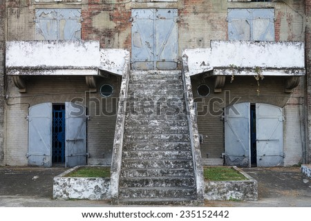 The Facade of An Old Japanese Military Facility, with Heavy Iron Blast Doors And A Stair Leading to The Second Floor. Built in 1917. Located in Kaohsiung, Taiwan.  - stock photo