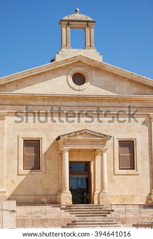 The facade of Malta Stock Exchange building, former Garrison Chapel. Valletta, Malta - stock photo