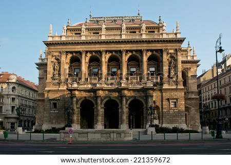 The facade of the State Opera House, in Budapest,  decorated with many arches and statues - stock photo