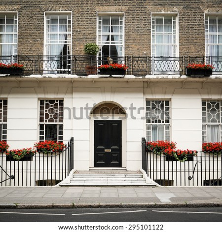 The facade to a traditional Georgian town house typical to the Bloomsbury district of central London. - stock photo