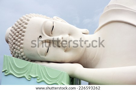 The face of Sleeping Buddha in Vietnam - stock photo