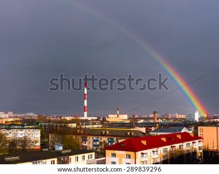 The Factory chimneys and rainbow.  - stock photo