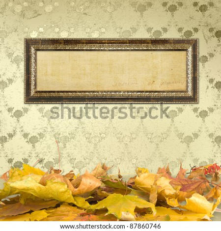 The fallen leaves on the floor and wooden picture frames - stock photo