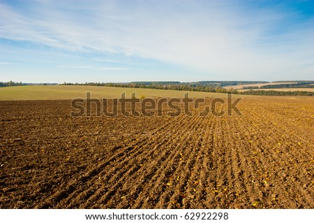 the fallow field is in autumn - stock photo