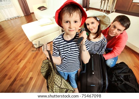 The family at home with a bigsuitcases - stock photo