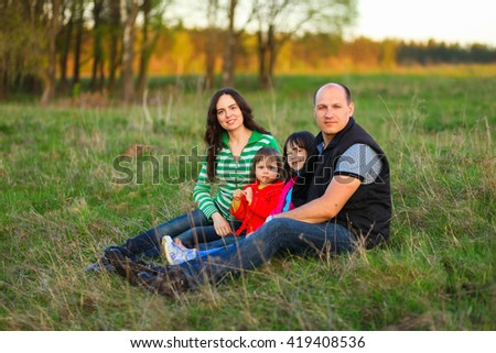 The Family happy outdoor rest a river. - stock photo