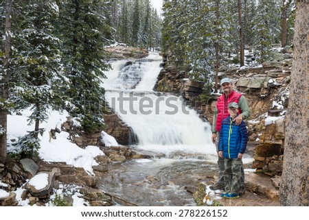 The family is at the upper level of the Provo River Waterfall. Uinta-Wasatch-Cache National Forest, Utah - stock photo