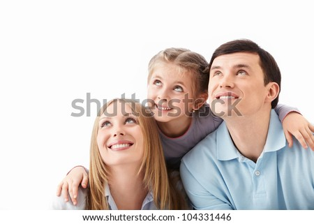 The family is looking up on white background - stock photo