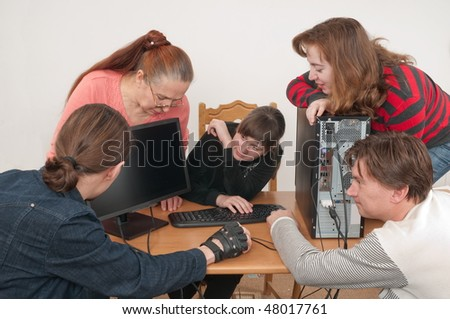 The family rejoices to acquisition of the new computer. - stock photo