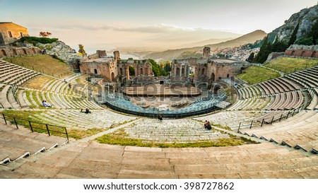 The famous and beautiful ancient greek theatre ruins Taormina in sunset, Messina, Sicily, Italy - stock photo