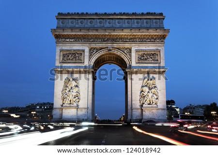 The famous Arc de Triomphe by night, Paris, France - stock photo