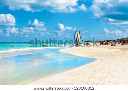 The famous beach of Varadero in Cuba  with a calm turquoise ocean - stock photo