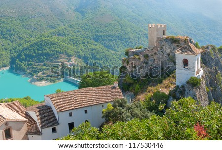 The famous Bell Tower and Gateway at Guadalest near Benidorm in Spain, horizontal - stock photo