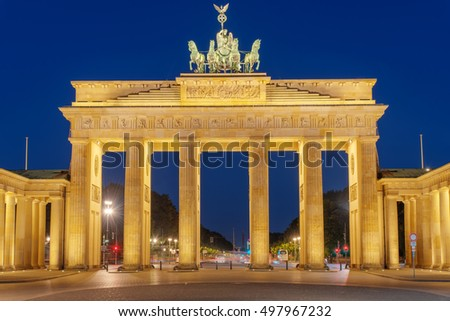 The famous Brandenburg Gate in Berlin illuminated at night, Germany