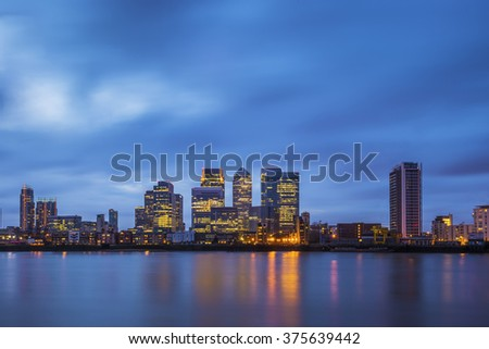 The famous business district and skyscrapers of Canary Wharf at blue hour - London, UK - stock photo