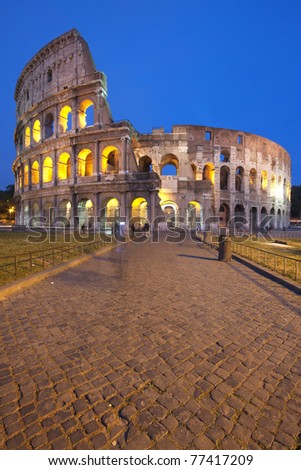 The famous Colosseum (or Coliseum) in Rome, Italy at dusk - stock photo