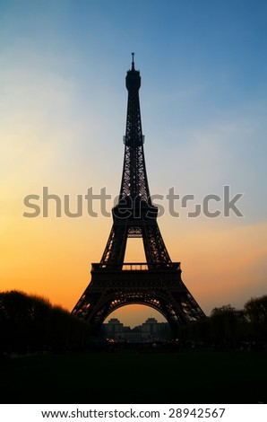 The famous Eiffel tower in Paris with a beautiful sunset - stock photo