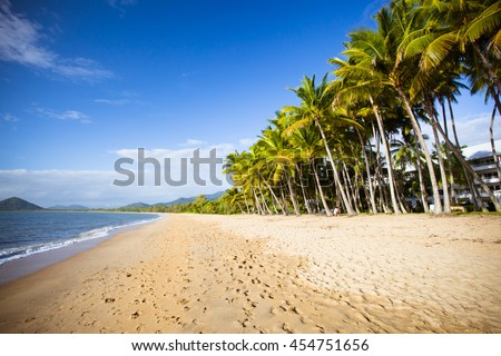 The famous idyllic beachfront of Palm Cove on a winter's day in Queensland, Australia - stock photo