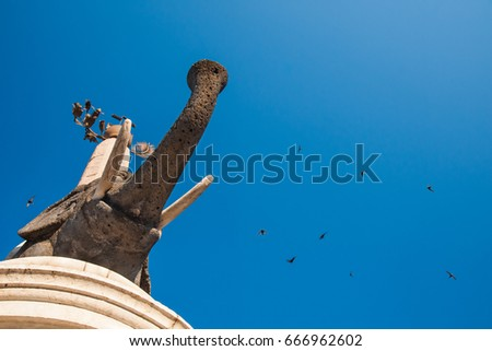 The famous lava stone statue of an elephant and its obelisk in Catania, Sicily, the symbol of the town