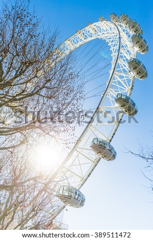 The famous London Eye ferris wheel with clear blue sky background - stock photo