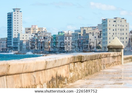 The famous malecon seawall in Havana vith a view of the city skyline - stock photo