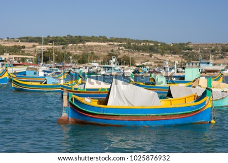 The famous Marsaxlokk harbor in Malta with the Luzzu boats.