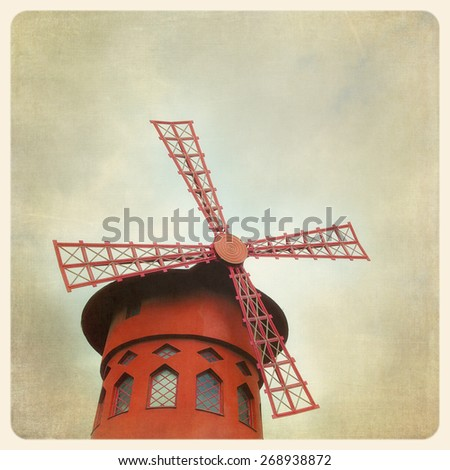 The famous Moulin Rouge in Paris, France. Filtered to look like and aged, instant photo - stock photo