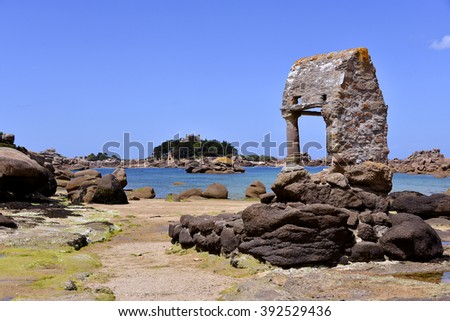 The famous old Oratoire Saint-Guirec building at low tide on the Pink Granite Coast (cote de granite rose in french) of Ploumanach, village in the commune of Perros-Guirec - stock photo