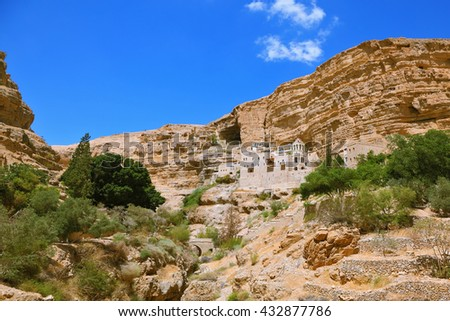 The famous Orthodox monastery of St. George. The building of the monastery was built on the wall of the gorge of Wadi Kelt. Israel - stock photo