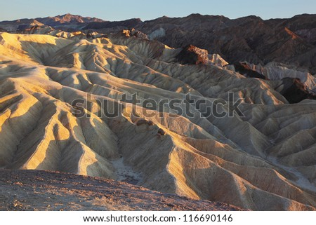 The famous part of Death Valley in California - Zabriskie Point. Sunset