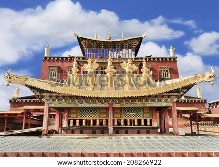 The famous Shangri-la Buddhist temple against a blue sky with dramatic clouds.  - stock photo