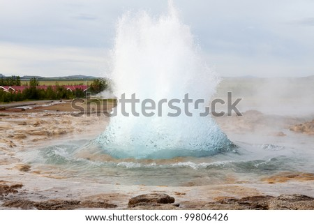 The famous Strokkur geyser in Iceland erupting - stock photo