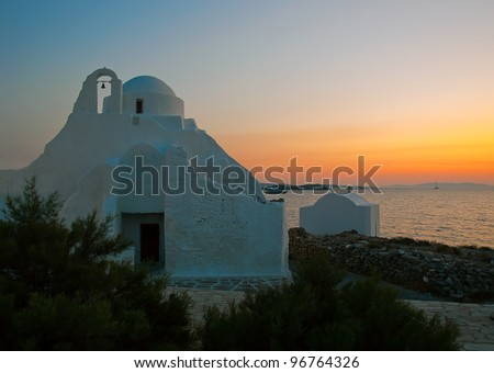 The famous 14th century church Paraportiani at sunset on the island of Mykonos. Greece. - stock photo