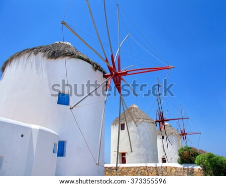 The famous traditional windmills on the island of Mykonos, Symbols of the cyclades islands of Greece - stock photo