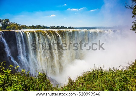 The famous Victoria Falls on the Zambezi River in South Africa. At the end of the rainy season, the waterfall most high water