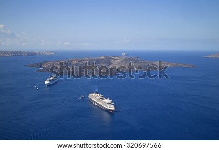 The famous volcanic islands surrounding the caldera of santorini  - stock photo