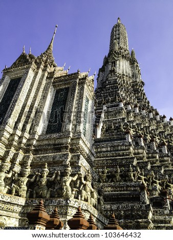 The famous Wat Arun, perhaps better known as the Temple of the Dawn, is one of the best known landmarks and one of the most published images of Bangkok. - stock photo