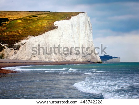 The famous white cliffs of Dover seen from the beach below - stock photo