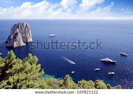 The Faraglioni in the southern coast of Capri island - stock photo