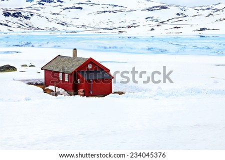 The farmhouse with wooden walls and tiled roof - stock photo