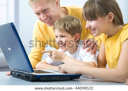 The father and its children use the laptop - stock photo