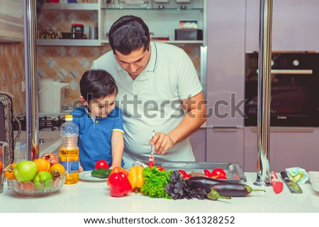 the father and the son cook food