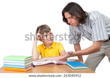 the father explains to his son-schoolboy solution of the task - stock photo